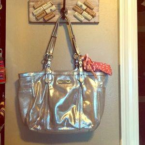 Shiny, metallic Coach purse